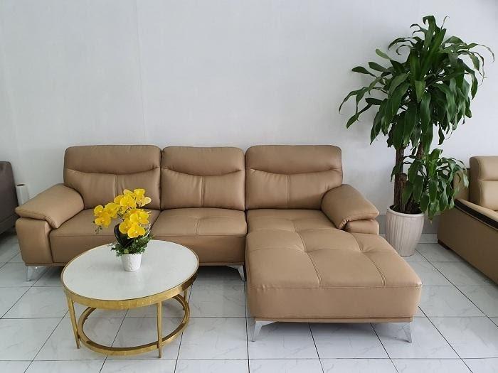 Bàn trà tròn sẽ hợp hơn với dáng sofa văng